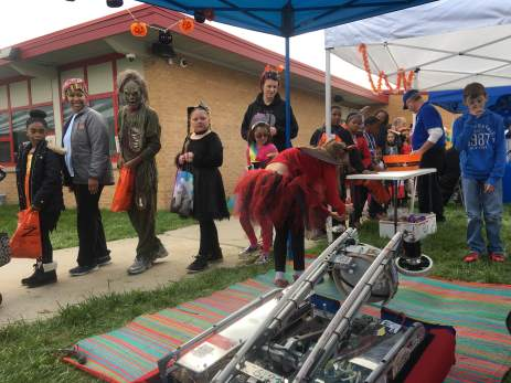 Third picture is of the Bentley Robotics teams handing out candy and demonstrating the robot.